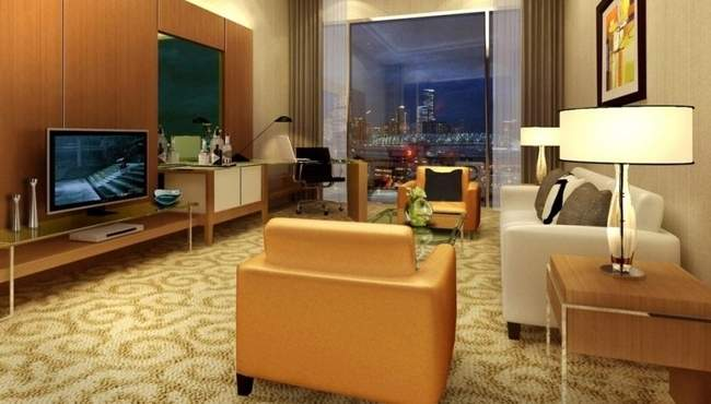 Country Inn and Suites by Radisson Sahibabad Ghaziabad living room.jpg