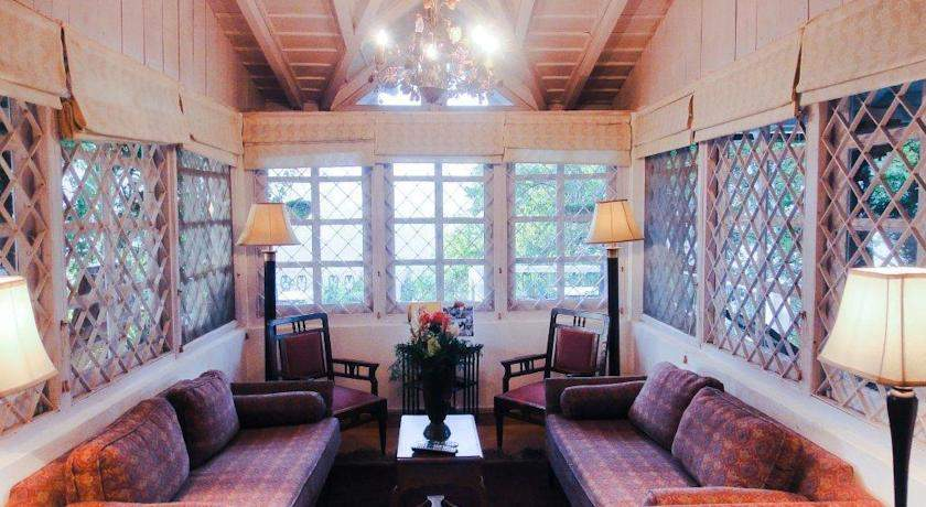 Neemrana Hotel The Ramgarh Bungalows Nainital living room.jpg
